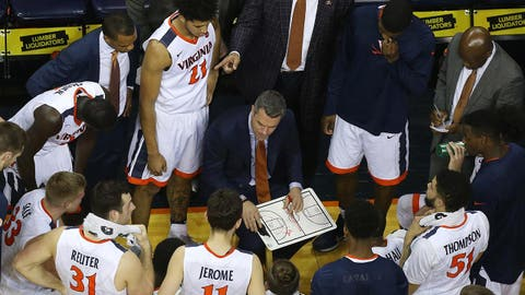 Feb 27, 2017; Charlottesville, VA, USA; Virginia Cavaliers head coach Tony Bennett (center) talks to his team in a huddle against the North Carolina Tar Heels in the second half at John Paul Jones Arena. The Cavaliers won 53-43. Mandatory Credit: Geoff Burke-USA TODAY Sports