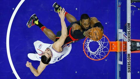 Atlanta Hawks' Dwight Howard, right, dunks the ball against Philadelphia 76ers' Dario Saric during the first half of an NBA basketball game, Wednesday, March 29, 2017, in Philadelphia. (AP Photo/Matt Slocum)