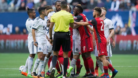 Toronto FC's Jozy Altidore (17) yells at Vancouver Whitecaps' Kendall Waston, center left, as the teams scuffle during second-half MLS soccer game action in Vancouver, British Columbia, Saturday, March 18, 2017. (Darryl Dyck/The Canadian Press via AP)