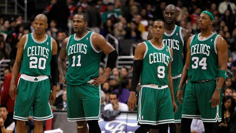 Boston Celtics players, guard Ray Allen (20), forward Glen Davis (11), guard Rajon Rondo (9), forward Kevin Garnett, second from right, and forward Paul Pierce (34) await the Los Angeles Clippers to take the court after a timeout during the second half of an NBA basketball game, Saturday, Feb. 26, 2011, in Los Angeles. Celtics won the game 99-92. (AP Photo/Alex Gallardo)
