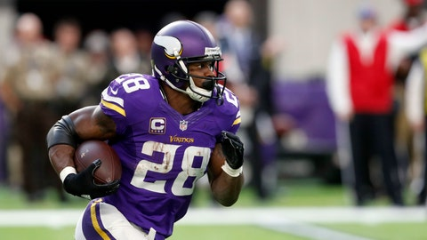 Minnesota Vikings running back Adrian Peterson runs with the ball during the second half of an NFL football game against the Indianapolis Colts Sunday, Dec. 18, 2016, in Minneapolis. (AP Photo/Charlie Neibergall)