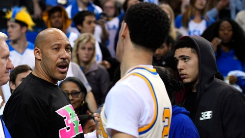 UCLA guard Lonzo Ball, right, shakes hands with his father LaVar following an NCAA college basketball game against Washington State, Saturday, March 4, 2017, in Los Angeles. UCLA won 77-68. (AP Photo/Mark J. Terrill)