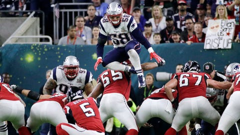 FILE - In this Feb. 5, 2017, file photo, New England Patriots' Shea McClellin (58) leaps over the line of scrimmage in an attempt to block a kick during the first half of the NFL Super Bowl 51 football game in Houston. NFL owners will consider proposals next week to cut regular-season overtime from 15 minutes to 10; eliminate players leaping over the line on kick plays; and expansion of coaches' challenges and what can be reviewed by officials.   (AP Photo/Jae C. Hong, File)