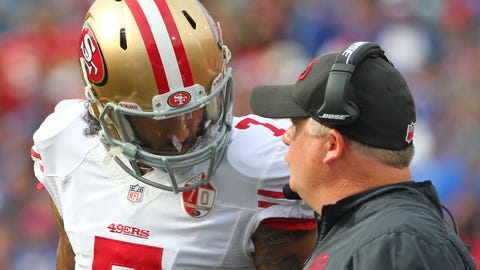 San Francisco 49ers head coach Chip Kelly talks to quarterback Colin Kaepernick during the first half of an NFL football game against the Buffalo Bills on Sunday, Oct. 16, 2016, in Orchard Park, N.Y. (AP Photo/Bill Wippert)