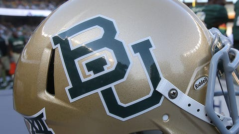 Baylor football helmet on the sidelines during their game with Rice at an NCAA college football game, Saturday, Sept. 26, 2015, in Waco, Texas. (AP Photo/Rod Aydelotte)