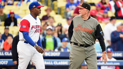 LOS ANGELES, CA - MARCH 20: Carlos Delgado #25 a coach of team Puerto Rico and Bert Blyleven #28 a coach of team Netherlands walk out to throw a ceremonial pitch at the start of Game 1 of the Championship Round of the 2017 World Baseball Classic at Dodger Stadium on March 20, 2017 in Los Angeles, California.  (Photo by Harry How/Getty Images)