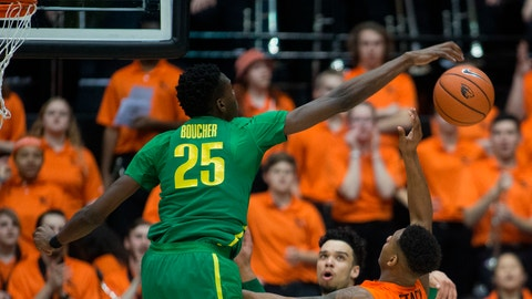 Oregon's Chris Boucher (25) blocks the shot of Oregon State's Ronnie Stacy (2) during the first half of an NCAA college basketball game Saturday, March 4, 2017, in Corvallis, Ore. (AP Photo/Timothy J. Gonzalez)