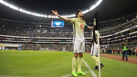 America's Oribe Peralta celebrates after scoring during a Mexico soccer league match against Cruz Azul, in Mexico City, Saturday, Feb. 25, 2017. (AP Photo/Christian Palma)