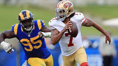 LOS ANGELES, CA - DECEMBER 24:  William Hayes #95 of the Los Angeles Rams pursues Colin Kaepernick #7 of the San Francisco 49ers during the first half of their game at Los Angeles Memorial Coliseum on December 24, 2016 in Los Angeles, California.  (Photo by Sean M. Haffey/Getty Images)