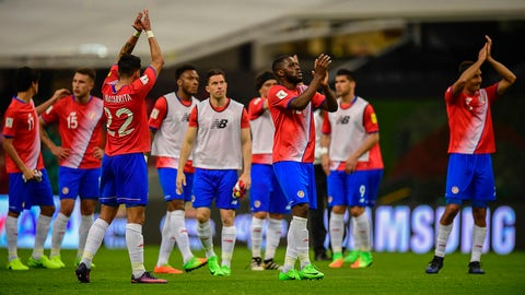 Costa Rican players applaud at the end of their 2018 FIFA World Cup qualifier football match against Mexico in Mexico City on March 24, 2017. / AFP PHOTO / RONALDO SCHEMIDT /   (Photo credit should read RONALDO SCHEMIDT/AFP/Getty Images)