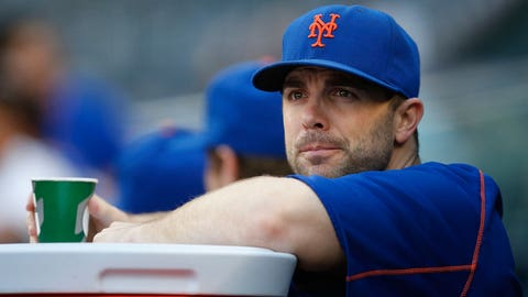 FILE - In this Aug. 4, 2016, file photo, injured New York Mets third baseman David Wright watches from the dugout before an interleague baseball game against the New York Yankees in New York. New York team captain Wright is not sure how an intangible issue like character factors into wins and losses and the divisional race in the National League East, but the lifelong Met is impressed by the leadership qualities in the clubhouse around him. (AP Photo/Kathy Willens, File)
