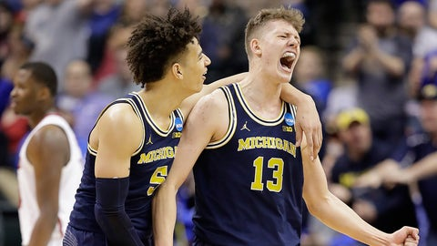 INDIANAPOLIS, IN - MARCH 19:  Moritz Wagner #13 of the Michigan Wolverines celebrates a shot with D.J. Wilson #5 in the second half against the Louisville Cardinals during the second round of the 2017 NCAA Men's Basketball Tournament at the Bankers Life Fieldhouse on March 19, 2017 in Indianapolis, Indiana. Michigan Wolverines won 73-69.  (Photo by Andy Lyons/Getty Images)