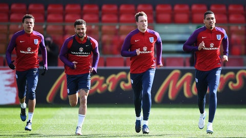BURTON-UPON-TRENT, ENGLAND - MARCH 21: (L-R) Dele Alli, Kyle Walker, Phil Jones and Chris Smalling of England warm up during an England training session at St Georges Park on March 21, 2017 in Burton-upon-Trent, England.  (Photo by Michael Regan - The FA/The FA via Getty Images)