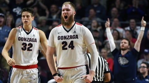 LAS VEGAS, NV - MARCH 07:  Zach Collins #32 of the Gonzaga Bulldogs looks on as teammate Przemek Karnowski #24 reacts after hitting a shot and getting fouled during the championship game of the West Coast Conference Basketball Tournament against the Saint Mary's Gaels at the Orleans Arena on March 7, 2017 in Las Vegas, Nevada. Gonzaga won 74-56.  (Photo by Ethan Miller/Getty Images)