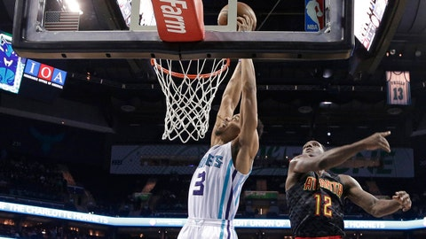Charlotte Hornets' Jeremy Lamb (3) dunks against Atlanta Hawks' Taurean Prince (12) and Ryan Kelly (30) during the first half of an NBA basketball game in Charlotte, N.C., Monday, March 20, 2017. (AP Photo/Chuck Burton)
