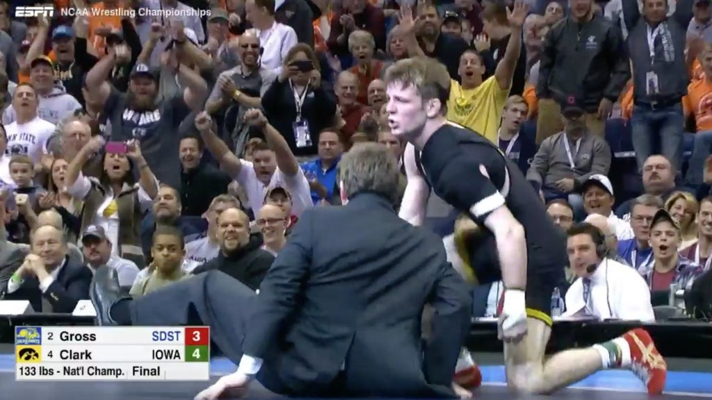 College wrestler wins national championship, takes down coach in