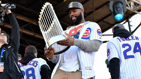 CHICAGO, IL - NOVEMBER 04: Chicago Cubs right fielder Jason Heyward (22) holds up the commissioners trophy during the Chicago Cubs World Series victory rally on November 4, 2016, at Grant Park in Chicago, IL. (Photo by Patrick Gorski/Icon Sportswire) (Icon Sportswire via AP Images)