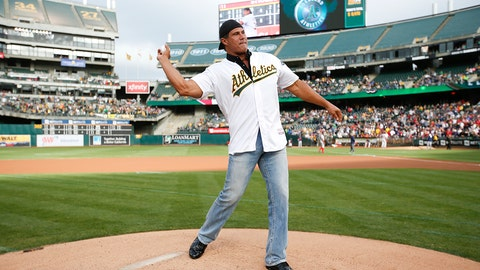 OAKLAND, CA - SEPTEMBER 3: Jose Canseco throws out the ceremonial first pitch prior to the game between the Oakland Athletics and the Boston Red Sox at the Oakland Coliseum on September 3, 2016 in Oakland, California. The Red Sox defeated the Athletics 11-2. (Photo by Michael Zagaris/Oakland Athletics/Getty Images)