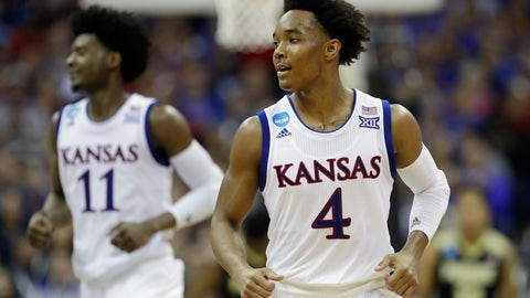 KANSAS CITY, MO - MARCH 23:  Devonte' Graham #4 of the Kansas Jayhawks reacts in the second half against the Purdue Boilermakers during the 2017 NCAA Men's Basketball Tournament Midwest Regional at Sprint Center on March 23, 2017 in Kansas City, Missouri.  (Photo by Jamie Squire/Getty Images)