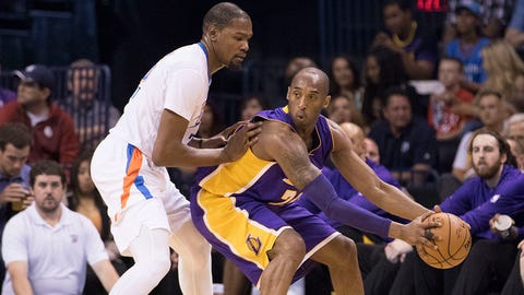 OKLAHOMA CITY, OK - APRIL 11: Kobe Bryant #24 of the Los Angeles Lakers tries to drive around Kevin Durant #35 of the Oklahoma City Thunder during a NBA game at the Chesapeake Energy Arena on April 11, 2016 in Oklahoma City, Oklahoma. NOTE TO USER: User expressly acknowledges and agrees that, by downloading and or using this photograph, User is consenting to the terms and conditions of the Getty Images License Agreement. (Photo by J Pat Carter/Getty Images)