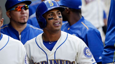 Seattle Mariners' Leonys Martin looks out from the dugout after scoring against the Houston Astros in a baseball game Sunday, Sept. 18, 2016, in Seattle. (AP Photo/Elaine Thompson)