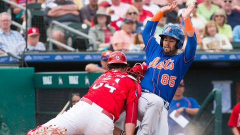 07 March 2016:  New York Mets Non-Roster Invitee Infielder Luis Guillorme (85) scores a run as he slides across home plate and into St. Louis Cardinals Catcher Mike Ohlman (84) during a MLB spring training game in which the St. Louis Cardinals defeated the New York Mets 9 to 4 at Roger Dean Stadium in Jupiter, FL. (Photo by Doug Murray/Icon Sportswire) (Icon Sportswire via AP Images)