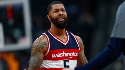 Washington Wizards forward Markieff Morris talks to teammates as he returns to the bench after being called for a flagrant foul against Denver Nuggets center Mason Plumlee late in the second half of an NBA basketball game Wednesday, March 8, 2017, in Denver. The Wizards won 123-113. Morris was ejected from the game. (AP Photo/David Zalubowski)