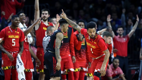 Maryland guard Jaylen Brantley (1) and his teammates react after he made a basket during the second half of an NCAA college basketball game against Rutgers Tuesday, Feb. 28, 2017, in Piscataway, N.J. Maryland won 79-59. (AP Photo/Mel Evans)