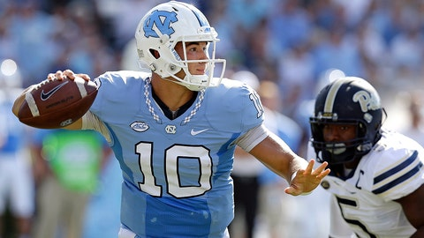FILE - In this Sept. 24, 2016, file photo, North Carolina quarterback Mitch Trubisky (10) throws a pass as Pittsburgh's Ejuan Price (5) rushes during the first half of an NCAA college football game in Chapel Hill, N.C. Trubisky has thrown for at least 400 yards in three straight games entering Saturday's visit from No. 25 Virginia Tech. (AP Photo/Gerry Broome, File)