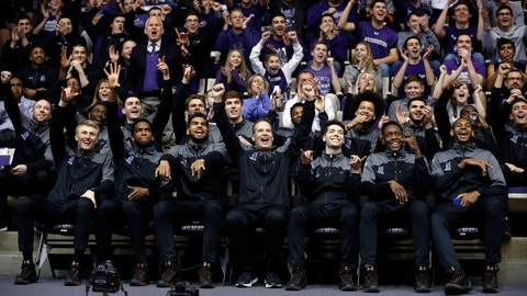 Northwestern head coach Chris Collins, center, and players react during a NCAA Division I Men's Basketball Tournament Selection Show watch party, Sunday, March 12, 2017 at Welsh-Ryan Arena in Evanston, Illinois. This is the first time that Northwestern Men's Basketball team has been selected to play in the NCAA Tournament. Northwestern will play against Vanderbilt in the first round. (AP Photo/Nam Y. Huh)