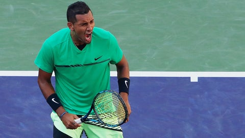 INDIAN WELLS, CA - MARCH 15:  Nick Kyrgios of Australia celebrates match point against Novak Djokovic of Serbia in their fourth round match during day ten of the BNP Paribas Open at Indian Wells Tennis Garden on March 15, 2017 in Indian Wells, California.  (Photo by Clive Brunskill/Getty Images)