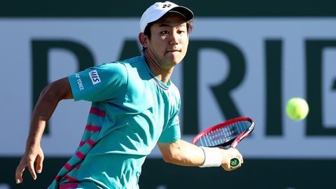 INDIAN WELLS, CA - MARCH 13:  Yoshihito Nishioka of Japan returns a shot to Tomas Berdych of Czech Republic during the BNP Paribas Open at the Indian Wells Tennis Garden on March 13, 2017 in Indian Wells, California.  (Photo by Matthew Stockman/Getty Images)
