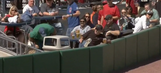 Fan fishes foul ball out of trash can, for some reason