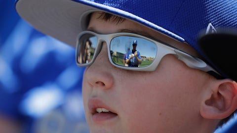 Billy Burns' reflection in a young fan's glasses