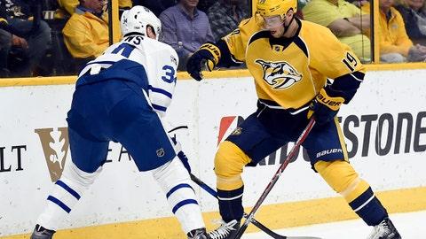 Nashville Predators center Calle Jarnkrok (19), of Sweden, battles Toronto Maple Leafs center Auston Matthews (34) for the puck during the first period of an NHL hockey game Thursday, March 30, 2017, in Nashville, Tenn. (AP Photo/Mark Zaleski)