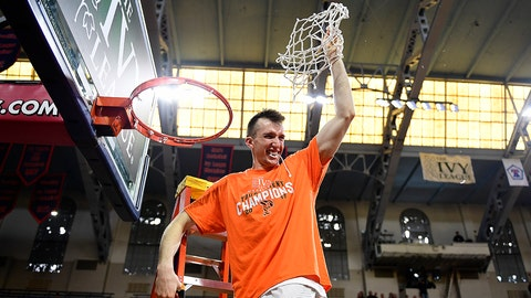 PHILADELPHIA, PA - MARCH 12: Steven Cook #25 of the Princeton Tigers is the last to cut down the whole net after the win against the Yale Bulldogs in the Ivy League tournament final at The Palestra on March 12, 2017 in Philadelphia, Pennsylvania. Princeton won 71-59. (Photo by Corey Perrine/Getty Images)