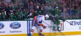 Stars player slides across dasher before scoring goal