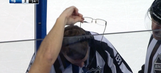 Hockey fan generously offers glasses to referee during video review