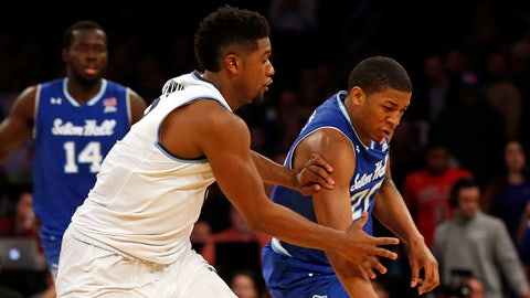 Mar 10, 2017; New York, NY, USA; Seton Hall Pirates forward Desi Rodriguez (20) scrambles for a loose ball in front of Villanova Wildcats forward Kris Jenkins (2) during the Big East Conference Tournament at Madison Square Garden. Mandatory Credit: Adam Hunger-USA TODAY Sports