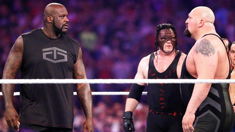 IMAGE DISTRIBUTED FOR WWE - NBA legend Shaquille O'Neal, left, faces off with WWE superstar The Big Show at WWE WrestleMania 32 at AT&T Stadium on Sunday, April 3, 2016, in Arlington, Texas. (Brandon Wade/AP Images for WWE)