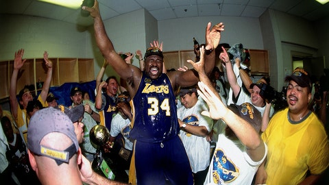 PHILADELPHIA - JUNE 15:  Shaquille O'Neal #34 of the Los Angelels Lakers celebrates winning the NBA Championship with a bottle of champagne after defeating the Philadelphia 76ers game five of the 2001 NBA Finals played June 15, 2001 at the First Union Center in Philadelphia, Pennsylvania.  NOTE TO USER: User expressly acknowledges that, by downloading and or using this photograph, User is consenting to the terms and conditions of the Getty Images License agreement. Mandatory Copyright Notice: Copyright 2001 NBAE (Photo by Andrew D. Bernstein/NBAE via Getty Images)