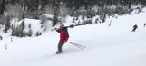 Video: Skier effortlessly glides down mountain in just his boots