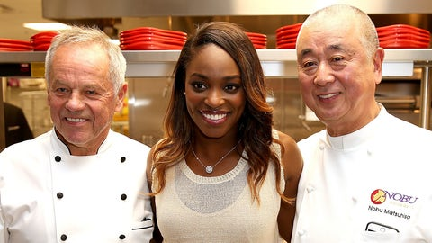 INDIAN WELLS, CA - MARCH 07:  WTA player Sloane Stephens poses with celebrity chefs Wolfgang Puck and Nobu Matsuhisa during the BNP Paribas Open at the Indian Wells Tennis Garden on March 7, 2017 in Indian Wells, California.  (Photo by Matthew Stockman/Getty Images)