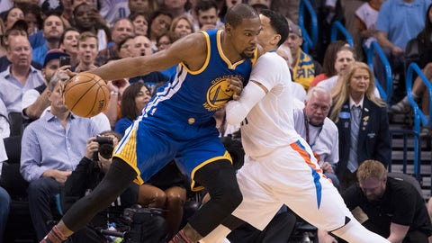 OKLAHOMA CITY, OK - FEBRUARY 11:  Kevin Durant #35 of the Golden State Warriors tries to push his way around Andre Roberson #21 of the Oklahoma City Thunder during the first half of a NBA game at the Chesapeake Energy Arena on February 11, 2017 in Oklahoma City, Oklahoma.   NOTE TO USER: User expressly acknowledges and agrees that, by downloading and or using this photograph, User is consenting to the terms and conditions of the Getty Images License Agreement. (Photo by J Pat Carter/Getty Images)