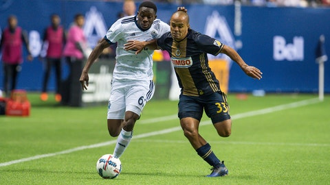 VANCOUVER, BC - MARCH 05: Vancouver Whitecaps forward Alphonso Davies (67) and Philadelphia Union defender Fabinho (33) battle for the ball during the game between the Vancouver Whitecaps and the Philadelphia Union at BC Place on March 5, 2017 in Vancouver, Canada. (Photo by Derek Cain/Icon Sportswire via Getty Images)