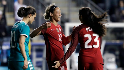 United States' Lynn Williams (12) and Christen Press (23) celebrate near Germany's Dzsenifer Marozsan (10) after Williams' goal during the second half of a SheBelieves Cup women's soccer match, Wednesday, March 1, 2017, in Chester, Pa. The United States won 1-0. (AP Photo/Matt Slocum)