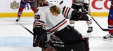 Corey Crawford stays in game after being felled by rocket slap shot to the mask