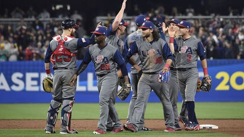 SAN DIEGO, CA - MARCH 18: United States players celebrate after beating the Dominican Republic 6-3 in World Baseball Classic Pool F Game Six at PETCO Park on March 18, 2017 in San Diego, California.  (Photo by Denis Poroy/Getty Images)