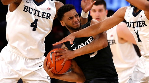 Mar 9, 2017; New York, NY, USA; Butler Bulldogs forward Tyler Wideman (4) and guard Kethan Savage (11) pressure Xavier Musketeers guard Trevon Bluiett (5) during the  first half of Big East Conference Tournament Quarterfinals at Madison Square Garden.  Mandatory Credit: Noah K. Murray-USA TODAY Sports