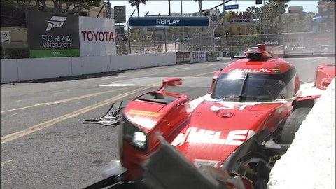 Dane Cameron slams into the wall from third place in the No. 31 Action Express Racing Cadillac DPi.